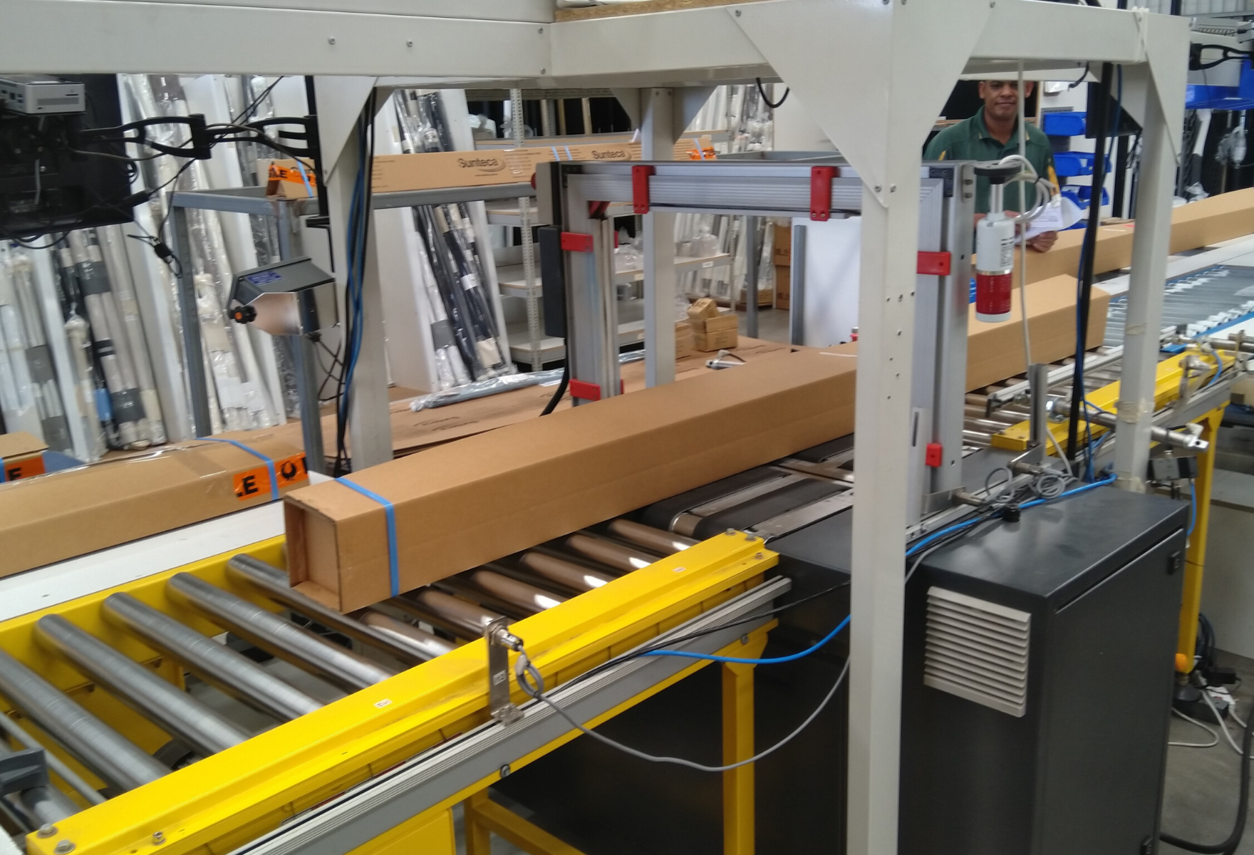 Automatic strapping of cartons