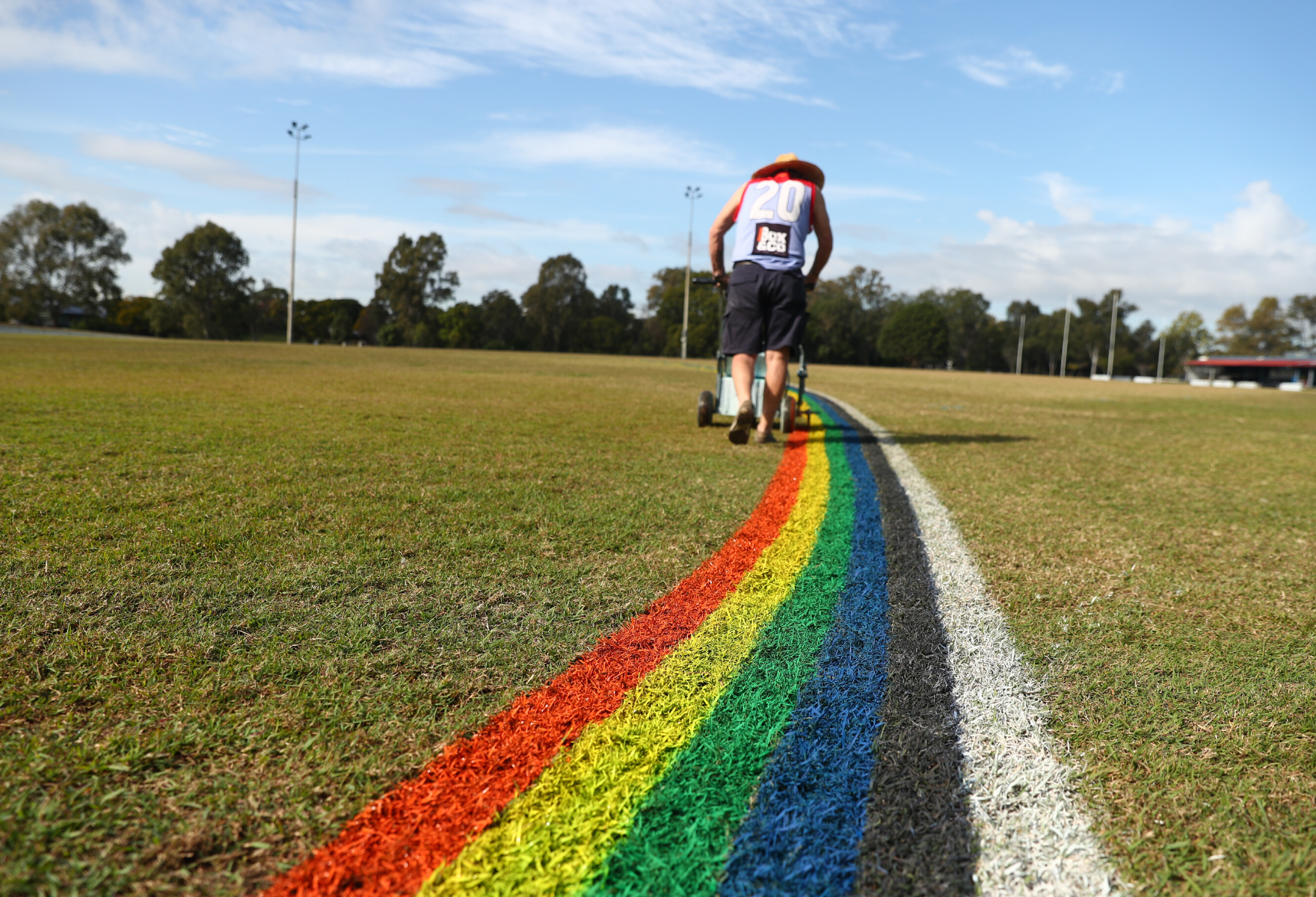 Football field being marked with rainbow