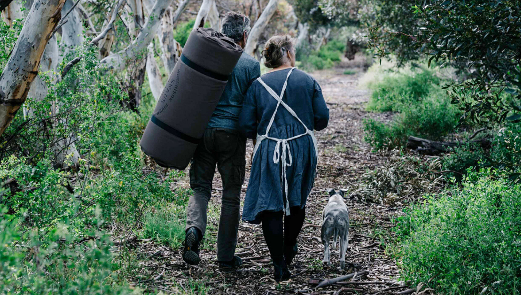 Gabrielle and John Andrews walking with Murchison River Swag