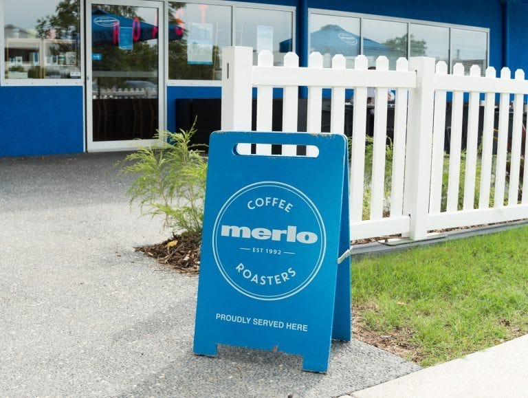 Merlo Coffee Roasters sign outside cafe