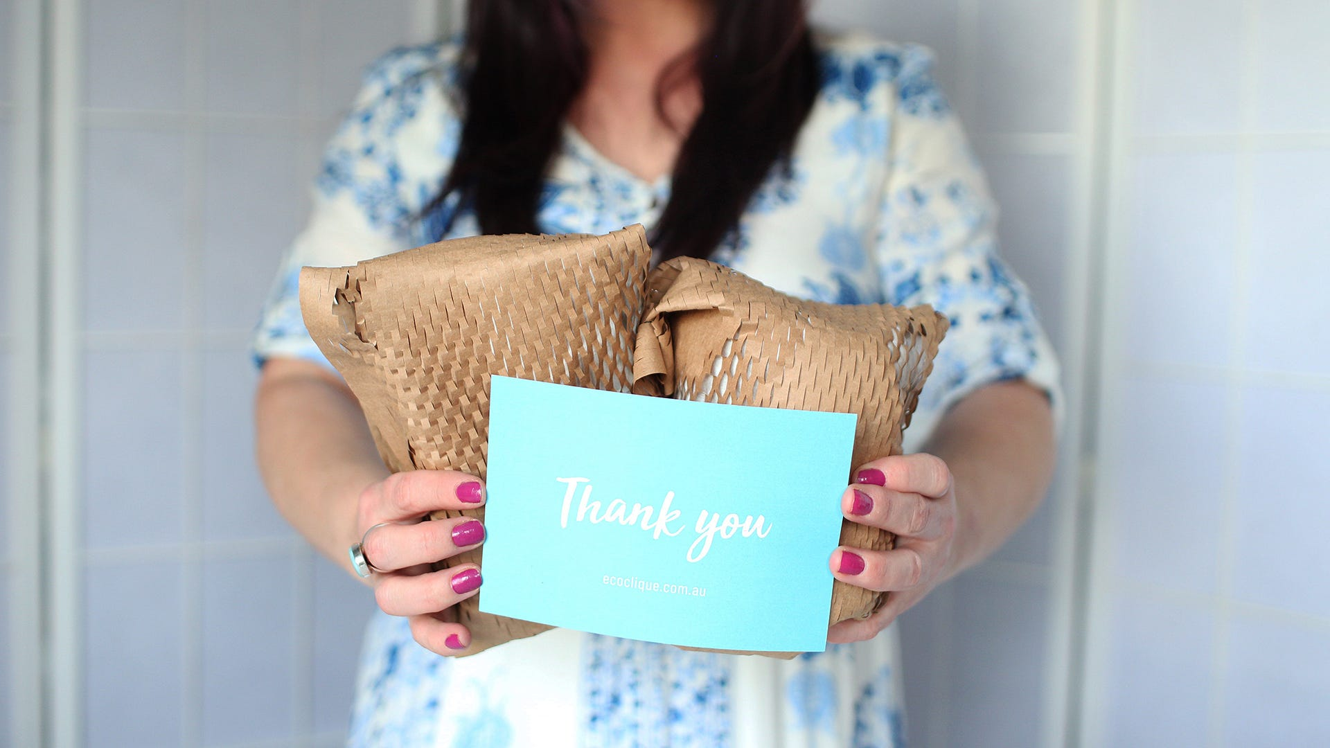 Simone holding packages with thank you note
