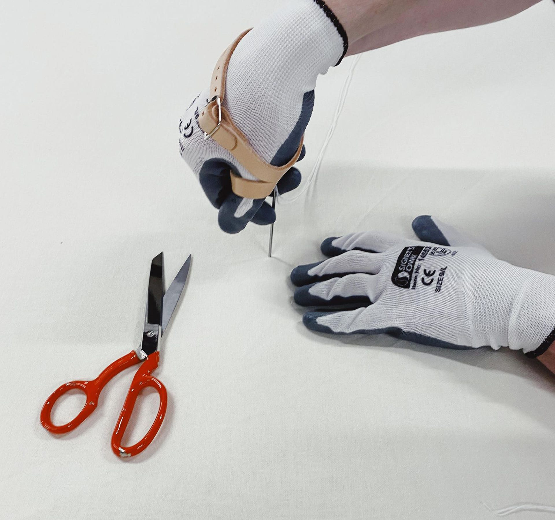 Tufting a mattress with Signet's Own Foam Nitrile Gloves